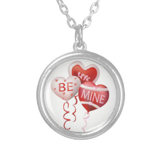 Heart shaped balloons in color with words of love. round pendant necklace