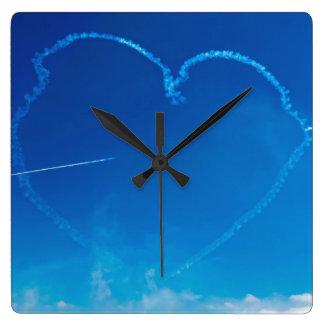 Heart-shaped plane trails wall clock
