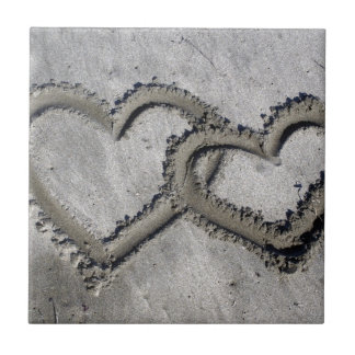 Hearts Linked in the Sand Ceramic Tile