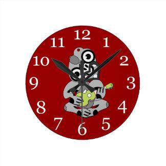 Hei Tiki playing ukelele Wall Clock