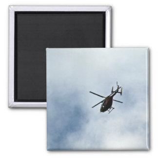 Helicopter flying towards blue sky magnet