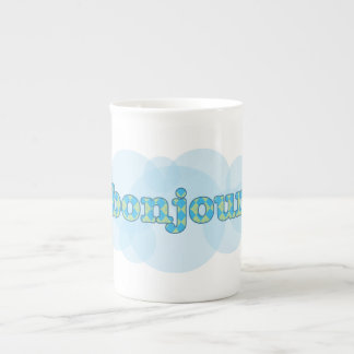 Hello in french bonjour with  argyle pattern tea cup
