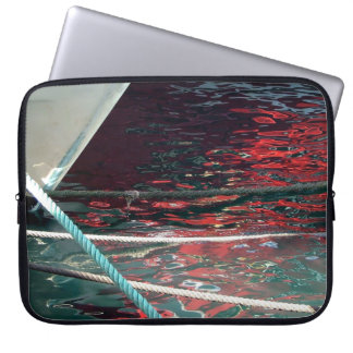 Helmet of fishing boat and reflections in the laptop computer sleeves