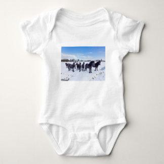 Herd of black frisian horses in winter snow baby bodysuit