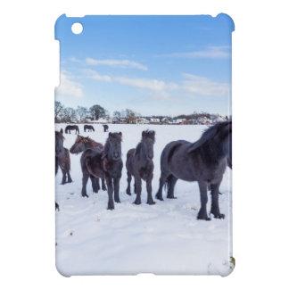 Herd of black frisian horses in winter snow iPad mini cases