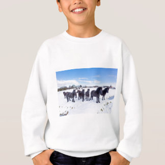 Herd of black frisian horses in winter snow sweatshirt