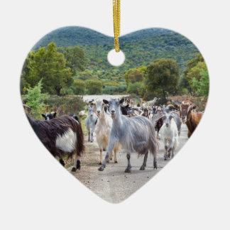 Herd of mountain goats walking on road ceramic heart decoration