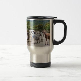 Herd of mountain goats walking on road travel mug