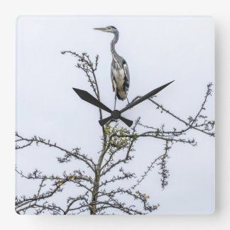Heron on a tree wall clock