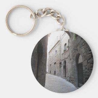 Hidden alley in Volterra village, province of Pisa Basic Round Button Key Ring