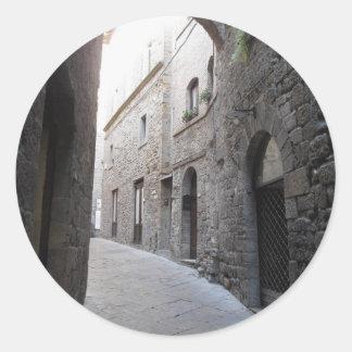 Hidden alley in Volterra village, province of Pisa Classic Round Sticker