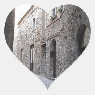 Hidden alley in Volterra village, province of Pisa Heart Sticker