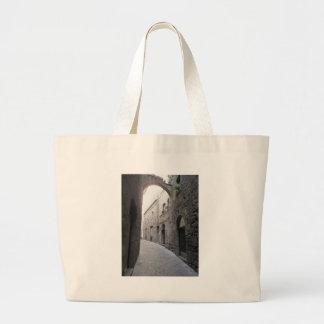 Hidden alley in Volterra village, province of Pisa Large Tote Bag
