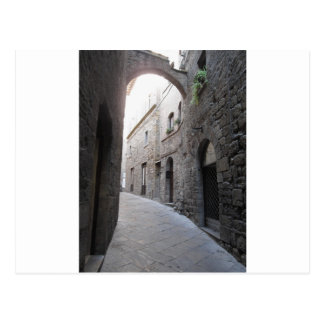Hidden alley in Volterra village, province of Pisa Postcard