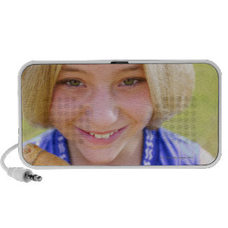 High angle portrait of a softball player smiling travel speakers