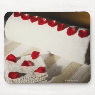 High angle view of rose petals on towels mouse pad