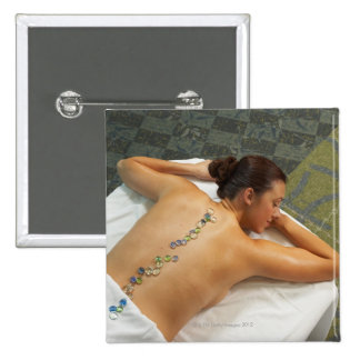 High angle view of woman receiving hot stone 15 cm square badge