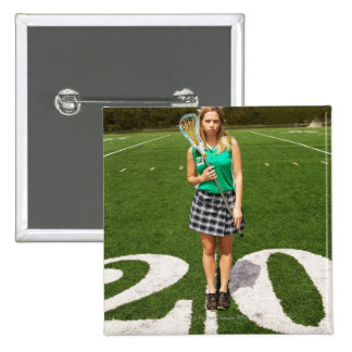 High school lacrosse player (16-18) holding 15 cm square badge