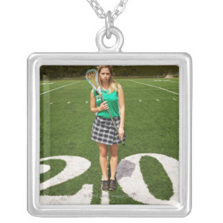 High school lacrosse player (16-18) holding custom jewelry