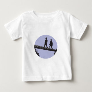 Hikers Crossing Single Log Bridge Oval Woodcut Baby T-Shirt
