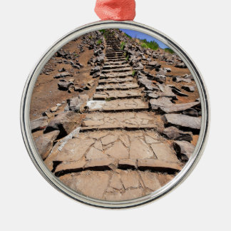 Hiking trail leading up the mountain on Madeira Metal Ornament