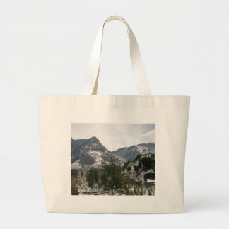 Hills covered with snow tote bag