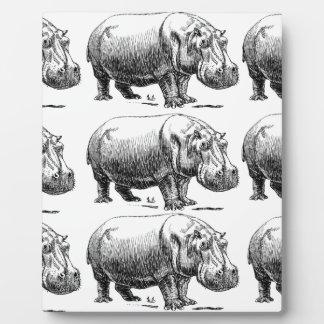 hippopotamus gold plaque