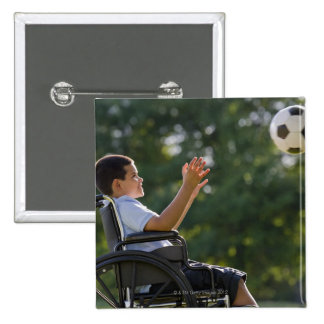Hispanic boy, 8, in wheelchair with soccer ball pinback buttons
