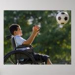Hispanic boy, 8, in wheelchair with soccer ball print