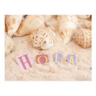 Hola, hello in Spanish on a sandy beach Postcard