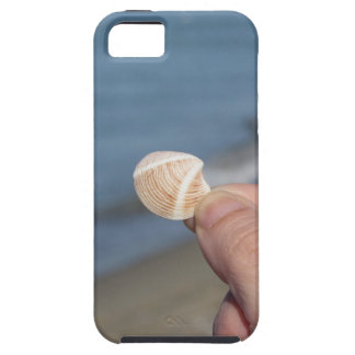Holding a seashell in the hand iPhone 5 cases