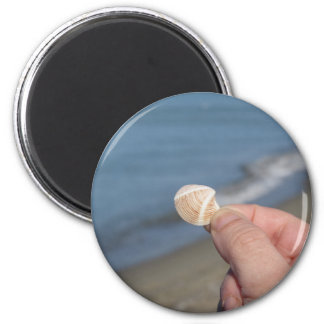Holding a seashell in the hand magnet