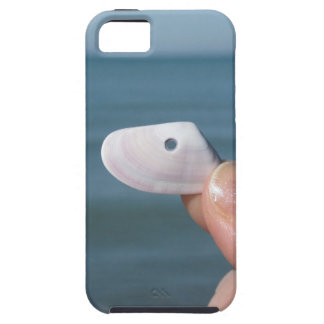 Holding a seashell in the hand with blue sea iPhone 5 case