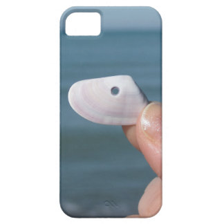 Holding a seashell in the hand with blue sea iPhone 5 cover