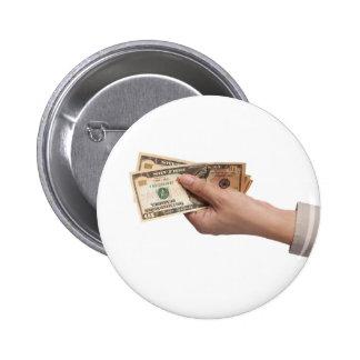 Holding money 6 cm round badge