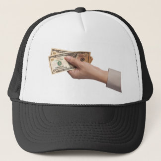 Holding money trucker hat