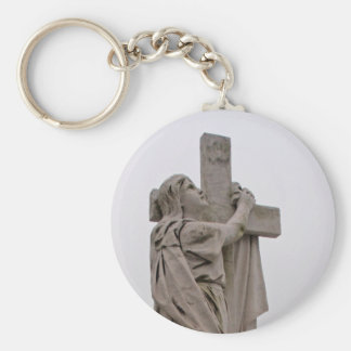 Holding the cross key chain