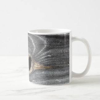 hole in fence coffee mug