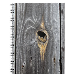 hole in fence notebook