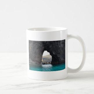 Hole in Rock in the Ocean Coffee Mug