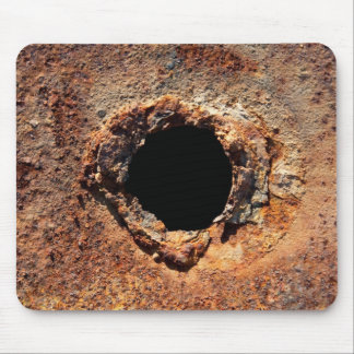 Hole in rust mouse pads