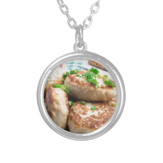 Homemade chicken burgers and tomato salad silver plated necklace