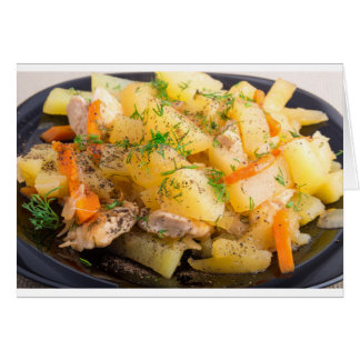 Homemade dish of slices of stewed potatoes card