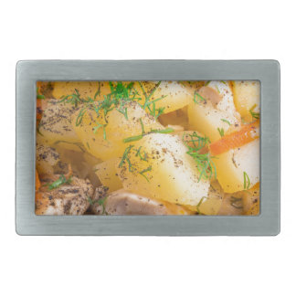Homemade dish of slices of stewed potatoes rectangular belt buckles