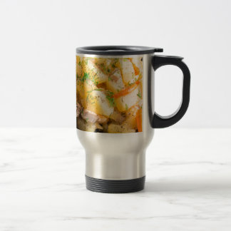 Homemade dish of slices of stewed potatoes travel mug