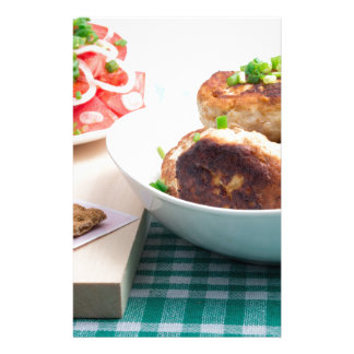 Homemade fried meatballs in a white bowl closeup stationery