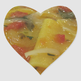 Homemade pasta with tomato sauce, onion, basil heart sticker