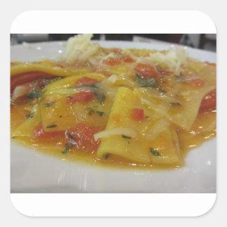 Homemade pasta with tomato sauce, onion, basil square sticker