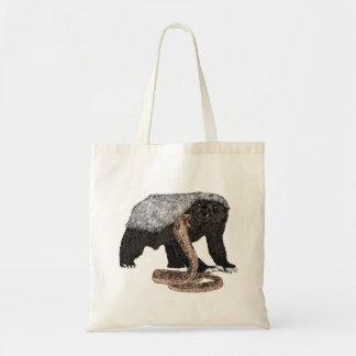 Honey Badger Taking on a cobra Tote Bag