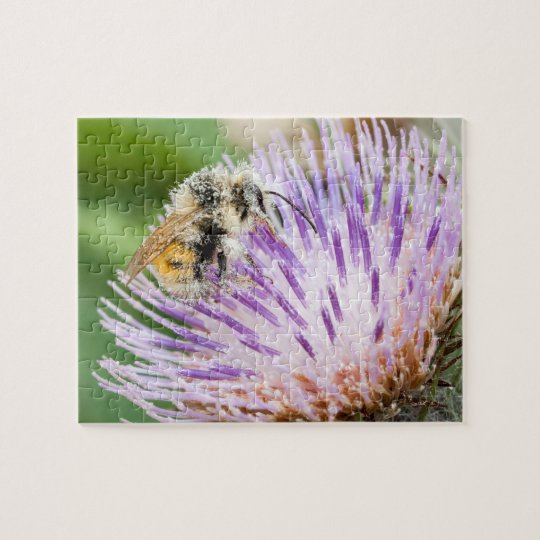 Honey bee gathering pollen on spiky purple thistle jigsaw puzzle